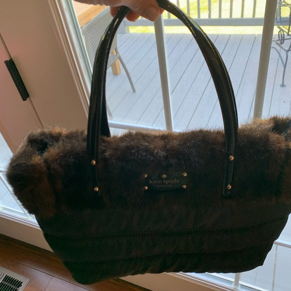 Kate Spade Black fabric handbag with brown fur top